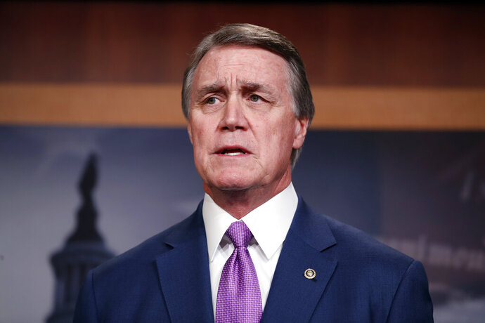 FILE - In this Monday, Feb. 12, 2018 file photo,Sen. David Perdue, R-Ga., speaks during a news conference about an immigration bill on Capitol Hill in Washington. The campaign of U.S. Sen. David Perdue has paid a $30,000 fine to federal regulators for violations discovered in the Georgia Republican's fundraising reports from the 2014 election. The civil penalty to the Federal Election Commission was disclosed in Perdue's latest campaign finance report filed Monday, April 15, 2019. (AP Photo/Alex Brandon, File)