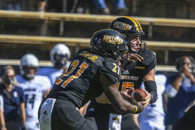Southern Miss quarterback Jack Abraham, hands off to  Frank Gore Jr., during an NCAA college football game against Rice in Hattiesburg, Miss., Saturday, Oct. 31, 2020. (Cam Bonelli/Hattiesburg American via AP)