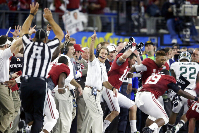 FILE - Alabama head coach Nick Saban and his team react at the end of the Cotton Bowl NCAA college football semifinal playoff game against Michigan State in Arlington, Texas, in this Thursday, Dec. 31, 2015, file photo. Alabama won 38-0 to advance to the championship game. Saban's dominating run at Alabama is more than just wins and championships. He's also ruined the careers of many of his fellow SEC coaches and cost the league's other 13 schools more than $100 million in buyouts -- all in search of someone who can knock the game's greatest coach from his perch.(AP Photo/LM Otero, File)