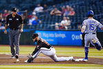 Texas Rangers' Nick Solak (15) is safe at first with an RBI single as Arizona Diamondbacks first baseman Christian Walker reaches out to make a late catch while umpire Pat Hoberg, left, watches during the fourth inning of a baseball game Wednesday, Sept. 8, 2021, in Phoenix. (AP Photo/Ross D. Franklin)