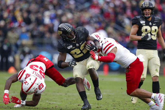 Purdue running back King Doerue (22) is tackled by Nebraska cornerback Dicaprio Bootle (23) and linebacker Collin Miller (31) during the first half of an NCAA college football game in West Lafayette, Ind., Saturday, Nov. 2, 2019. (AP Photo/Michael Conroy)