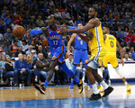 Oklahoma City Thunder's Dennis Schroder (17) fights for the ball with Golden State Warriors' Alec Burks (8) during the second half of an NBA basketball game in Oklahoma City, Saturday, Nov. 9, 2019. (AP Photo/Garett Fisbeck)
