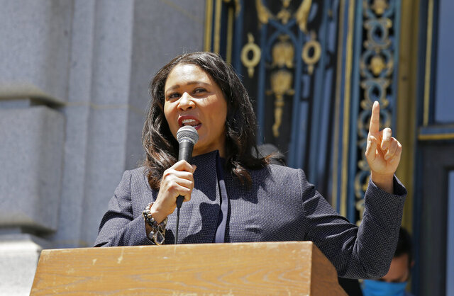 In this photo taken June 1, 2020, San Francisco Mayor London Breed speaks to a group protesting police racism outside City Hall in San Francisco. San Francisco police will stop responding to neighbor disputes, reports on homeless people, school discipline interventions and other non-criminal activities as part of a police reform plan announced Thursday, June 11, 2020. Mayor London Breed's said officers would be replaced on non-violent calls by trained and non-armed professionals to limit unnecessary confrontation between the police department and the community. (AP Photo/Eric Risberg)