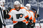 Philadelphia Flyers' Jakub Voracek (93) celebrates with teammates after scoring a goal during the second period of an NHL hockey game against the New York Islanders Thursday, April 8, 2021, in Uniondale, N.Y. (AP Photo/Frank Franklin II)