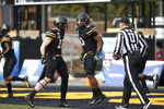 Appalachian State running back Darrynton Evans (3) celebrates his touchdown with tight end Mike Evans (18) during the first half of an NCAA college football game in the Sun Belt Football Championship against Louisiana-Lafayette on Saturday, Dec. 7, 2019, in Boone, N.C. (AP Photo/Brian Blanco)