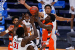Syracuse forward Kadary Richmond (3) shoots between a trio of San Diego State defenders during the first half of a college basketball game in the first round of the NCAA tournament at Hinkle Fieldhouse in Indianapolis, Friday, March 19, 2021. (AP Photo/AJ Mast)