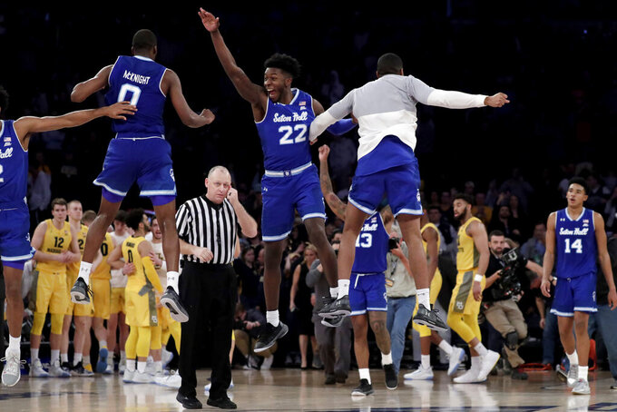Seton Hall guard Quincy McKnight (0) and guard Myles Cale (22) celebrate after defeating Marquette during an NCAA college basketball semifinal game in the Big East men's tournament, early Saturday, March 16, 2019, in New York. Seton Hall won 81-79. (AP Photo/Julio Cortez)