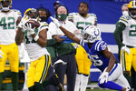 Green Bay Packers' Davante Adams (17) makes a catch against Indianapolis Colts' Rock Ya-Sin (26) during the first half of an NFL football game, Sunday, Nov. 22, 2020, in Indianapolis. (AP Photo/Michael Conroy)