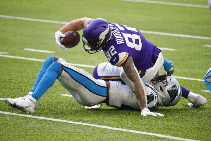 Minnesota Vikings tight end Kyle Rudolph (82) is tackled by Carolina Panthers safety Jeremy Chinn during the first half of an NFL football game, Sunday, Nov. 29, 2020, in Minneapolis. (AP Photo/Bruce Kluckhohn)