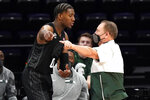Michigan State head coach Tom Izzo, right, points as he talks with forward Aaron Henry during the second half of an NCAA college basketball game against Northwestern in Evanston, Ill., Sunday, Dec. 20, 2020. Northwestern won 79-65. (AP Photo/Nam Y. Huh)