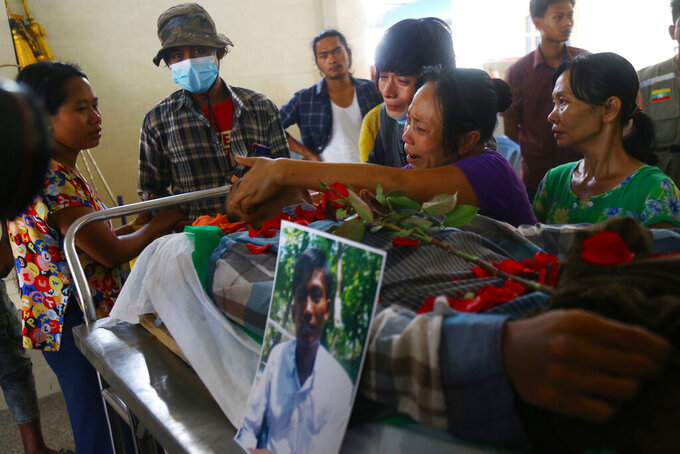 Family members mourn over the death of Aung Myo Thant during his funeral in Yangon, Myanmar, Tuesday, March 30, 2021. Aung Myo Thant was killed Monday during a clash with security forces at a protest against the military's coup that ousted the government of Aung San Suu Kyi. (AP Photo)