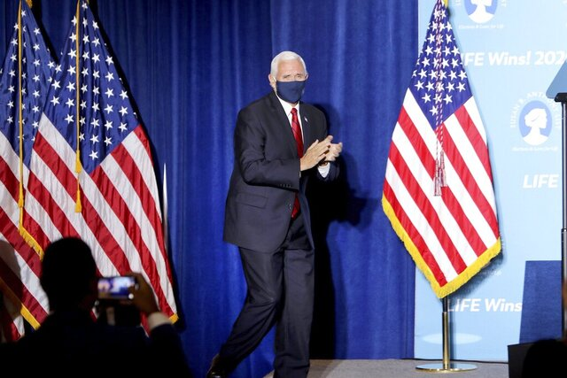 Vice President Mike Pence arrives to give a speech at Starkey Road Baptist Church on Wednesday Aug. 5, 2020, as part of his 'Faith in America' tour. His visit comes just days after President Donald Trump came to Tampa Bay on Friday for a campaign fundraiser. Pence's speech heralded the Trump Administration's successes and commitment to pro-life issues. (Douglas R. Clifford/Tampa Bay Times via AP)