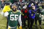 Green Bay Packers' Za'Darius Smith smiles as he takes a selfie after an NFL divisional playoff football game against the Seattle Seahawks Sunday, Jan. 12, 2020, in Green Bay, Wis. The Packers won 28-23 to advance to the NFC Championship. (AP Photo/Mike Roemer)