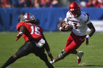 Louisville quarterback Malik Cunningham (3) runs against Western Kentucky defensive back Ta'Corian Darden (15) in the first half of an NCAA college football game, Saturday, Sept. 14, 2019, in Nashville, Tenn. (AP Photo/Mike Strasinger)