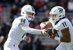 Michigan State quarterback Brian Lewerke (14) hands off to running back Connor Heyward (11) in the first half of an NCAA college football game against Maryland, Saturday, Nov. 3, 2018, in College Park, Md. (AP Photo/Gary Cameron)