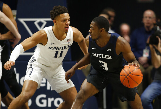 Butler guard Kamar Baldwin (3) is pressured by Xavier guard Bryce Moore (11) during the first half of an NCAA college basketball game, Saturday, March 7, 2020, in Cincinnati. (AP Photo/Gary Landers)