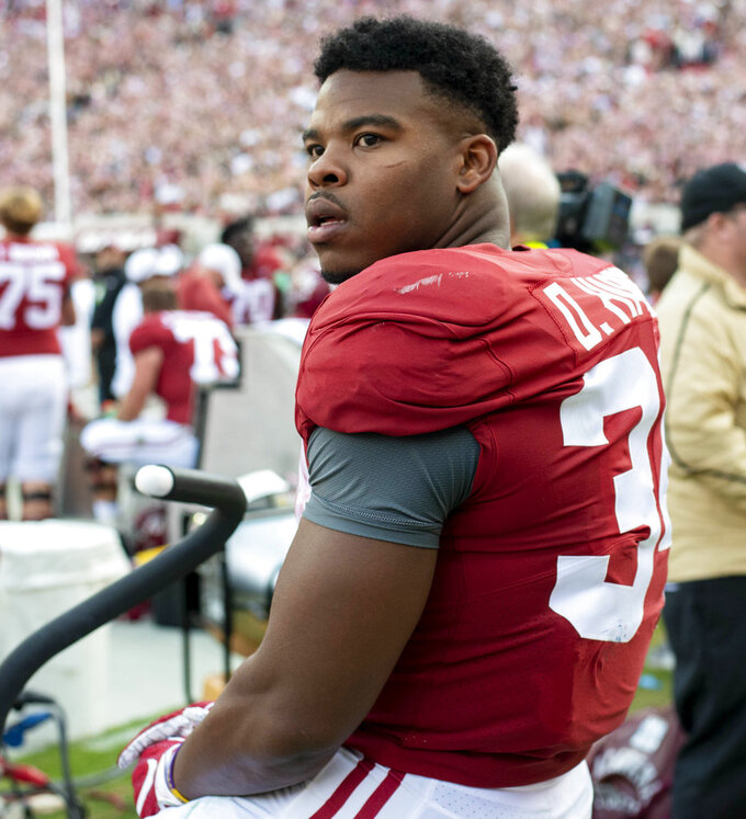 Alabama running back Damien Harris (34) rides a stationary bike during the first half of an NCAA college football game, against Auburn, Saturday, Nov. 24, 2018, in Tuscaloosa, Ala. (AP Photo/Vasha Hunt)