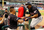 Cleveland Indians' Leonys Martin (2) celebrates with Francisco Lindor, right, after Lindor hit a solo home run in the fifth inning of a baseball game against the Texas Rangers in Arlington, Texas, Monday, June 17, 2019. (AP Photo/Tony Gutierrez)