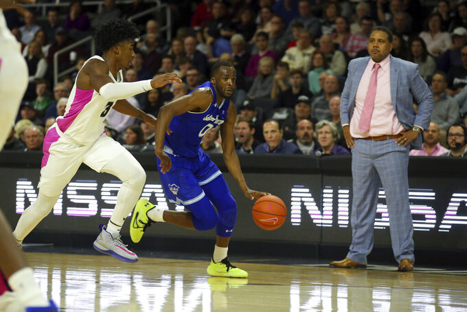 Providence's David Duke (3) defends against Seton Hall's Quincy McKnight (0) during the first half of an NCAA college basketball game Saturday, Feb. 15, 2020, in Providence, R.I. (AP Photo/Stew Milne)