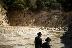 In this Thursday, Oct. 31, 2019 photo, ultra-Orthodox Jews visit the Tomb of the Kings, a large underground burial complex dating to the first century BC, in east Jerusalem neighborhood of Sheikh Jarrah. After several aborted attempts, the French Consulate General has reopened one of Jerusalem's most magnificent ancient tombs to the public for the first time in over a decade, sparking a distinctly Jerusalem conflict over access to an archaeological-cum-holy site in the volatile city's eastern half. (AP Photo/Ariel Schalit)