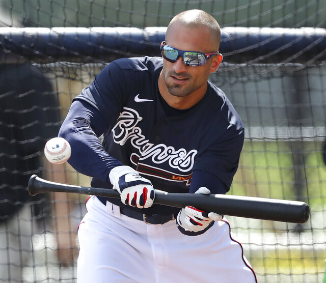 Atlanta Braves outfielder Nick Markakis lays down a bunt during spring training baseball practice in North Port, Fla., Tuesday, Feb. 18, 2020. (Curtis ompton/Atlanta Journal-Constitution via AP)
