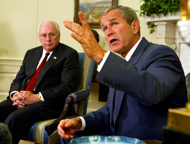 FILE - President George W. Bush, right, with Vice President Dick Cheney at his side, speaks during a meeting with congressional leaders in the White House Oval Office on Sept. 18, 2002. A new CNN Films documentary explores the role of the U.S. vice presidency, which in modern times has emerged into a more powerful position. Still, the film notes that  a veep's duties are all up to the president. (AP Photo/Doug Mills, File)