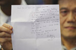 Hisyam Teh Poh Teck, lawyer of Vietnamese Doan Thi Huong, displays a letter written by Doan during a press conference at Sepang International Airport in Sepang, Malaysia, Friday, May 3, 2019. Vietnamese Doan Thi Huong, who was tried for the killing of the estranged half brother of North Korea's leader was released from a Malaysian prison and was planning to return home later Friday, her lawyer and an embassy translator said. (AP Photo/Vincent Thian)