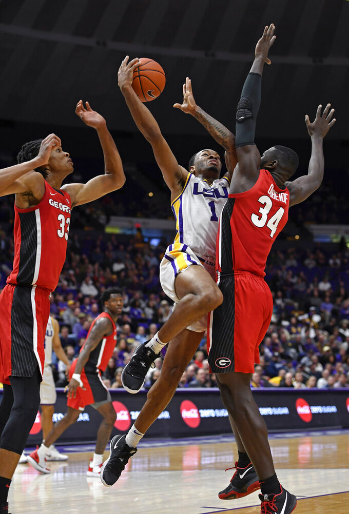 LSU guard Ja'vonte Smart (1) drives the basket as Georgia forward Nicolas Claxton (33) and Georgia forward Derek Ogbeide (34) defend in the first half of an NCAA college basketball game, Wednesday, Jan. 23, 2019, in Baton Rouge, La. (AP Photo/Bill Feig)
