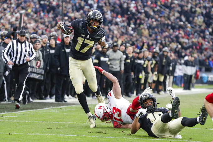 Purdue cornerback Byron Perkins (17) is tripped up by Nebraska linebacker JoJo Domann (13) during the first half of an NCAA college football game in West Lafayette, Ind., Saturday, Nov. 2, 2019. (AP Photo/Michael Conroy)