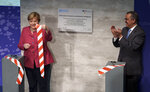 Tedros Adhanom Ghebreyesus, right, Director-General of the World Health Organization (WHO), and German Chancellor Angela Merkel, left, attend the inauguration ceremony of the 'WHO Hub For Pandemic And Epidemic Intelligence' at the Langenbeck-Virchow building in Berlin, Germany, Wednesday, Sept. 1, 2021. (AP Photo/Michael Sohn, pool)