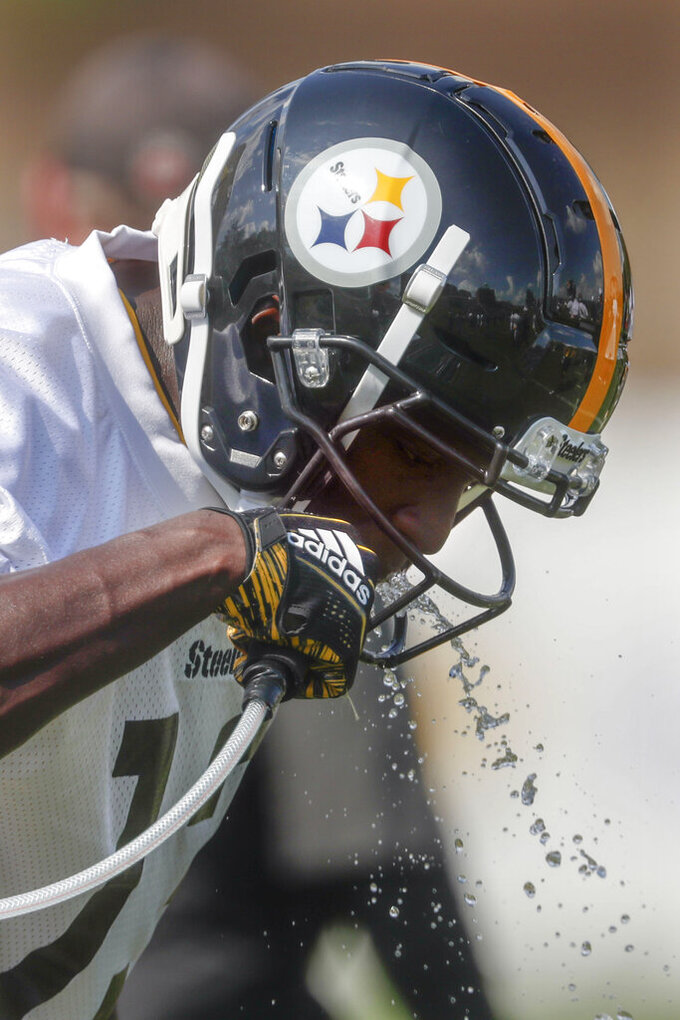Pittsburgh Steelers wide receiver James Washington gets a drink during their afternoon NFL football training camp practice in Latrobe, Pa., Saturday, July 27, 2019. (AP Photo/Keith Srakocic)