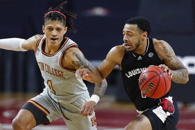 Louisville's Carlik Jones (1) drives past Boston College's Makai Ashton-Langford (4) during the first half of an NCAA college basketball game, Saturday, Jan. 2, 2021, in Boston. (AP Photo/Michael Dwyer)