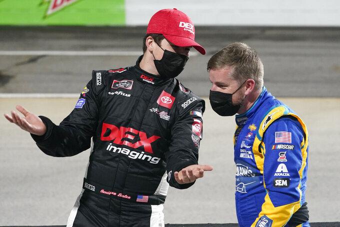 Harrison Burton, left, talks with Justin Allgaier before the NASCAR Xfinity Series auto race at Martinsville Speedway in Martinsville, Va., Friday, April 9, 2021. (AP Photo/Steve Helber)