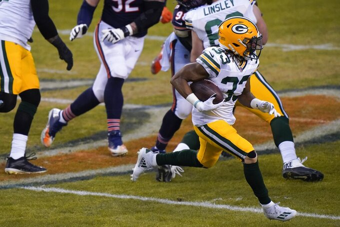 Green Bay Packers' Aaron Jones runs during the first half of an NFL football game against the Chicago Bears Sunday, Jan. 3, 2021, in Chicago. (AP Photo/Nam Y. Huh)