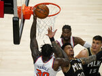 New York Knicks' Julius Randle (30) fouls Atlanta Hawks' John Collins (20) during the second half in Game 4 of an NBA basketball first-round playoff series Sunday, May 30, 2021, in Atlanta. (AP Photo/Brynn Anderson)