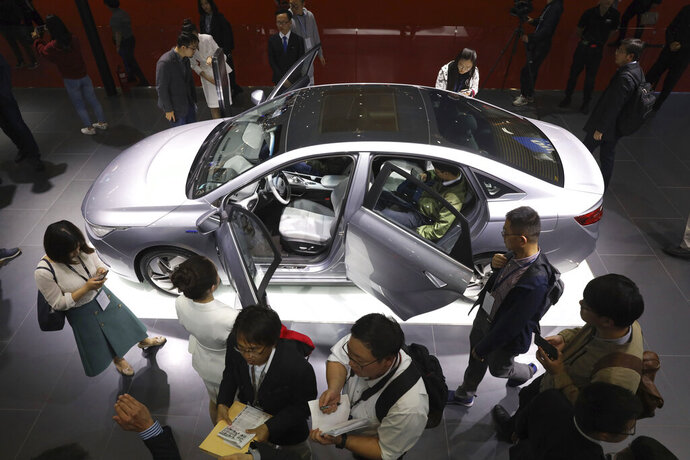 Chinese automaker Geely Auto displays a sedan from its new electric brand Geometry during the Auto Shanghai 2019 show in Shanghai Tuesday, April 16, 2019. Automakers are showcasing electric SUVs and sedans with more driving range and luxury features at the Shanghai auto show, trying to appeal to Chinese buyers in their biggest market as Beijing slashes subsidies that have propelled demand. (AP Photo/Ng Han Guan)