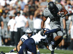Colorado running back Travon McMillian, right, pulls away from New Hampshire safety Pop Lacey for a short gain in the first half of an NCAA college football game Saturday, Sept. 15, 2018, in Boulder, Colo. (AP Photo/David Zalubowski)