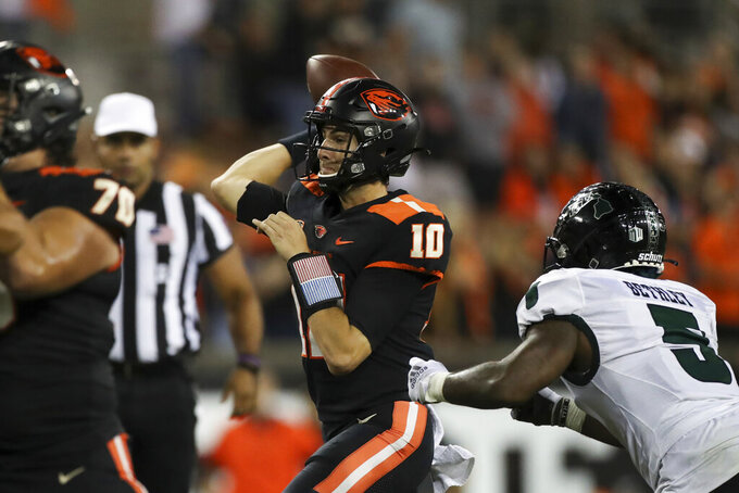 Oregon State quarterback Chance Nolan (10) throws a 13-yard pass to Oregon State wide receiver Anthony Gould (15) for a touchdown during the second half of an NCAA college football game against Hawaii, Saturday, Sept. 11, 2021, in Corvallis, Ore. Oregon State won 45-27. (AP Photo/Amanda Loman)