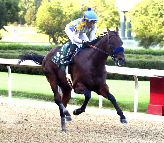 FILE - In this May 2, 2020, file photo, jockey Joel Rosario and Nadal cross the wire to win the second division of the Arkansas Derby horse race at Oaklawn in Hot Springs, Ark. Nadal, who now won't have a shot after an ankle injury in training last week, could have been racing to become trainer Bob Baffert's third Triple Crown winner in six seasons, if not for the coronavirus pandemic. The Belmont Stakes usually wraps up a five-week span that includes the Kentucky Derby and the Preakness. All have been pushed back, though the Belmont Stakes will now go first on June 20. (Richard Rasmussen/The Sentinel-Record via AP, File)