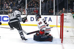 Los Angeles Kings forward Austin Wagner (51) scores on Chicago Blackhawks goalie Corey Crawford (50) during the second period of an NHL hockey game Saturday, March 30, 2019, in Los Angeles. (AP Photo/Ringo H.W. Chiu)