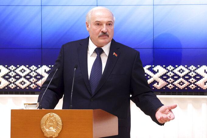 Belarus President Alexander Lukashenko speaks during a meeting with officials in Minsk, Belarus, Friday, July 23, 2021. (Nikolay Petrov/BelTA Pool Photo via AP)