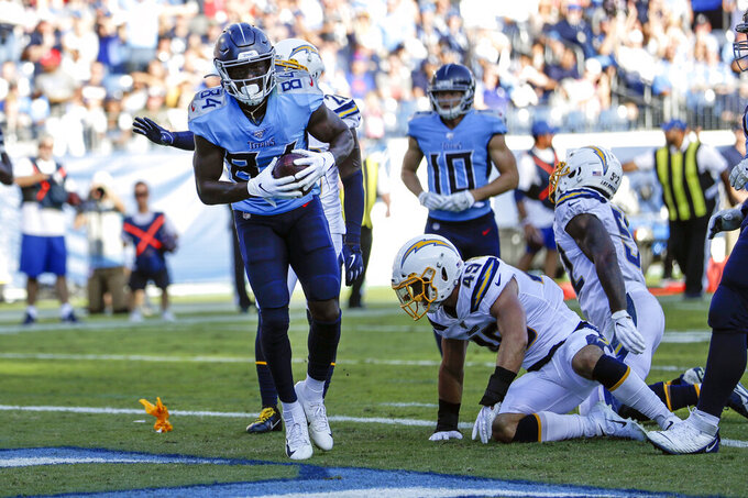 Tennessee Titans wide receiver Corey Davis (84) catches a touchdown pass against the Los Angeles Chargers in the first half of an NFL football game Sunday, Oct. 20, 2019, in Nashville, Tenn. (AP Photo/James Kenney)