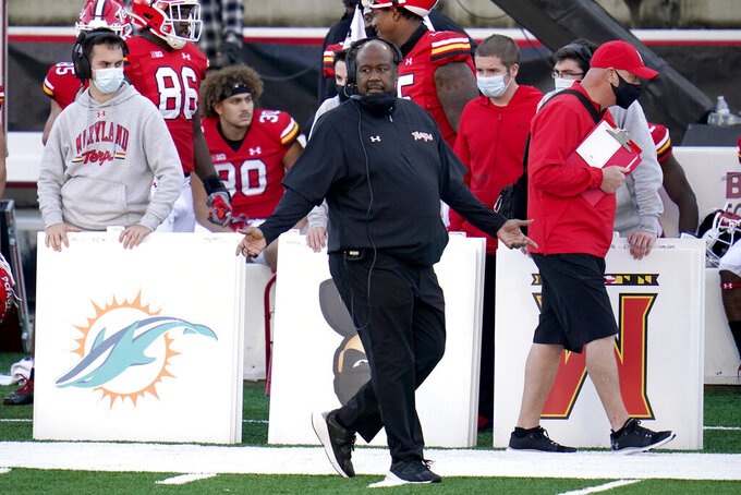 Maryland head coach Mike Locksley reacts during the second half of an NCAA college football game against Rutgers, Saturday, Dec. 12, 2020, in College Park, Md. Rutgers won 27-24 in overtime. (AP Photo/Julio Cortez)