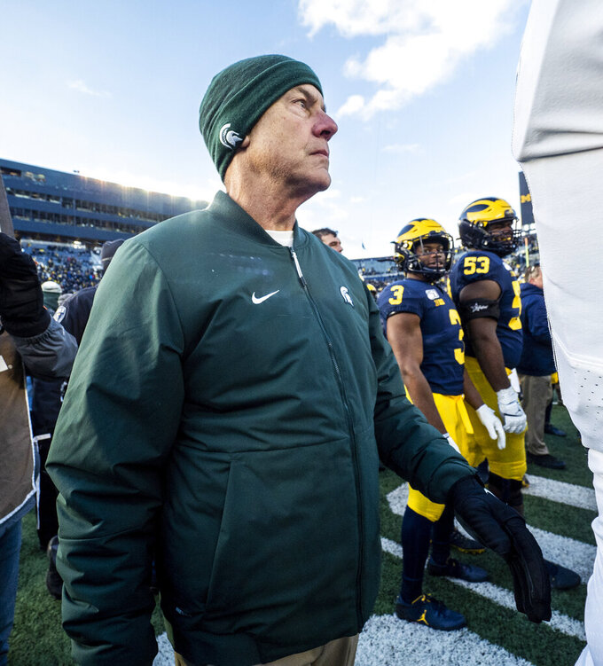 Michigan State head coach Mark Dantonio walks off the Michigan Stadium field after an NCAA college football game against Michigan in Ann Arbor, Mich., Saturday, Nov. 16, 2019. Michigan won 44-10. (AP Photo/Tony Ding)