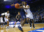 Buffalo guard CJ Massinburg (5) passes the ball past Akron forward Daniel Utomi (3) during the first half of an NCAA college Basketball game, Tuesday, Feb. 26, 2019, in Buffalo N.Y. (AP Photo/Jeffrey T. Barnes)