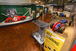 In this image provided by the The Henry Ford, various types of racing cars, including the 1967 Ford Mark IV Race Car, left, are on display as part of the Driven To Win exhibit at the The Henry Ford Museum in Dearborn, Mich. (Wes Duenkel/The Henry Ford via AP)