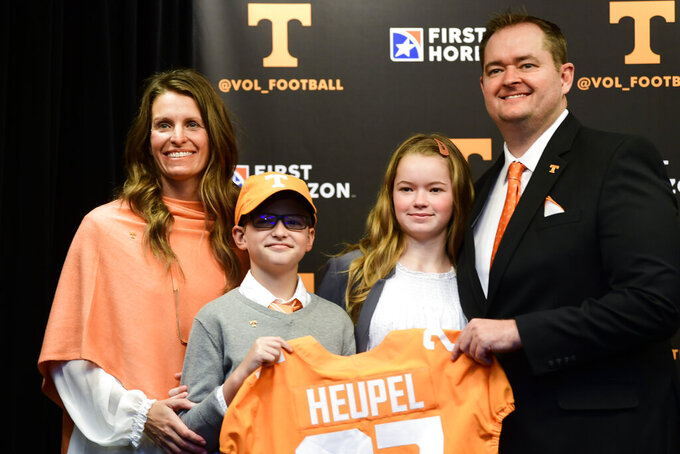 New Tennessee NCAA college football head coach Josh Heupel poses with his wife Dawn, son Jace, and daughter Hannah after an introductory press conference at Neyland Stadium in Knoxville, Tenn., Wednesday, Jan. 27, 2021. (Caitie McLekin/Knoxville News Sentinel via AP, Pool)
