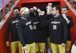 Boston College players gather before an NCAA college football game against Boston College, Saturday, Nov. 7, 2020, at the Carrier Dome in Syracuse, N.Y. (Dennis Nett/The Post-Standard via AP)