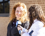 Jenny Cudd, left, a flower shop owner and former Midland mayoral candidate, leaves the federal courthouse in Midland, Texas, Wednesday, Jan. 13, 2021. The FBI arrested Cudd and Eliel Rosa on Wednesday in connection with the Jan. 6 insurrection at the U.S Capitol.  (Jacob Ford/Odessa American via AP)