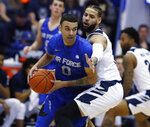 Air Force guard Caleb Morris, left, looks to pass the ball as Nevada forward Cody Martin defends during the first half of an NCAA college basketball game Tuesday, March 5, 2019, at Air Force Academy, Colo. (AP Photo/David Zalubowski)